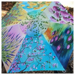 Garden umbrella, each panel handpainted with a flower scene © Samantha van der Westhuizen//100% Relvd